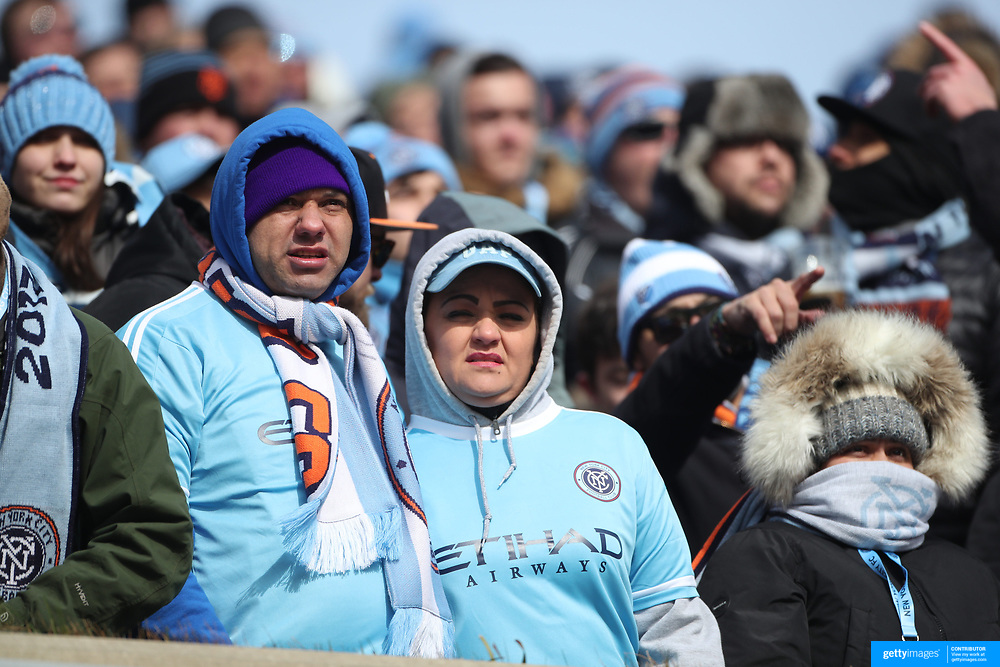 NEW YORK, NEW YORK - March 12:  New York City FC fans carving the bitter cold for their opening home game during the NYCFC Vs DC United<br />  regular season MLS game at Yankee Stadium on March 12, 2017 in New York City. (Photo by Tim Clayton/Corbis via Getty Images)