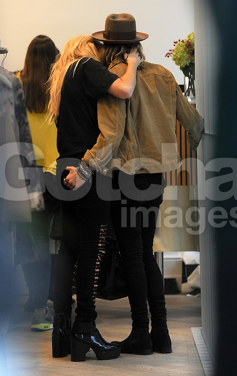 Singer Ellie Goulding and boyfriend Dougie Poynter out shopping at various shops, Victoria Beckham store, Chloe store, Acne store in London, UK. 26/09/2014<br />