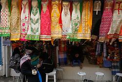 August 13, 2017 - Dhaka, Bangladesh - Bangladeshi cloth vendor decorates their cloth in front the shop inside street at Dhaka in Bangladesh on August 13, 2017. (Credit Image: © Mehedi Hasan/NurPhoto via ZUMA Press)