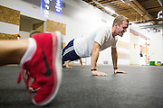 Stephen Reiners of San Jose completes a circuit of pushups during a CrossFit program at ThirdSpace Fitness in San Jose, California, on July 6, 2015. (Stan Olszewski/SOSKIphoto for Content Magazine)