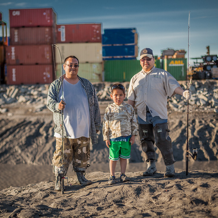 """Fishermen Peter Paneok, and Peter Makar with six year old Daniel at Ship Creek, Anchorage.  """"We both came here (Anchorage) from Bethel…there are a lot more opportunities here.""""  -Peter Paneok, resident since 2002  ppaneok@hotmail.com"""