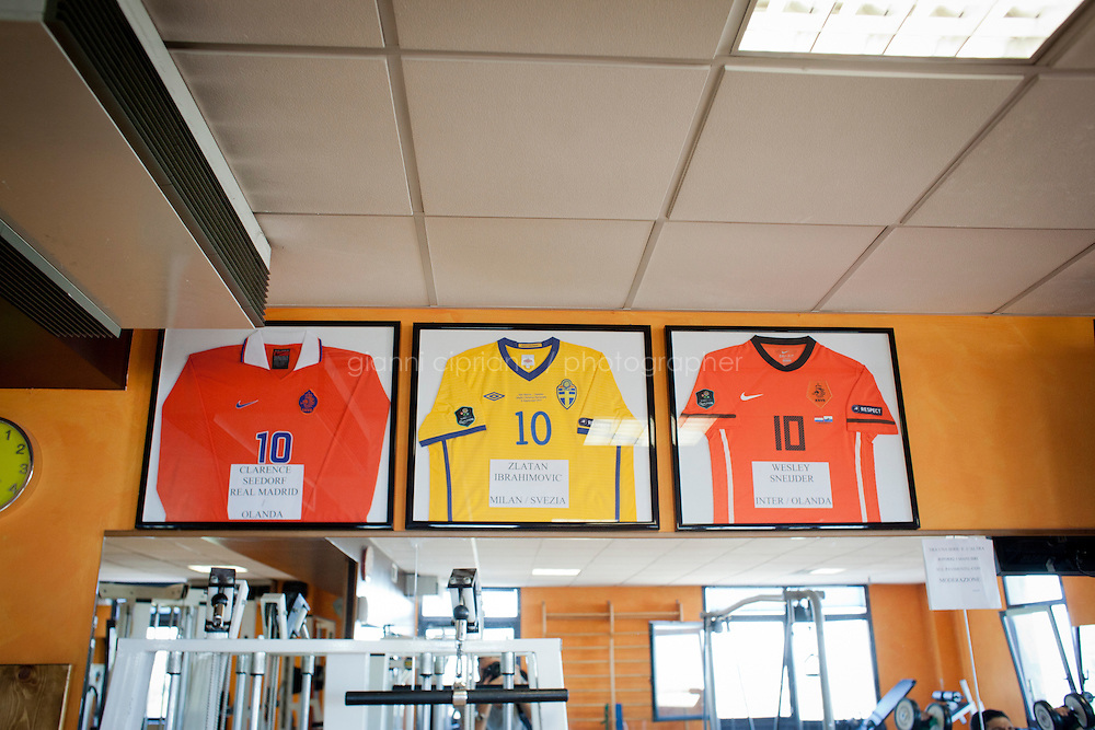 BORGO MAGGIORE, SAN MARNO - 3 OCTOBER 2011: Jerseys exchanged by San Marino defendant Damiano Vannucci, 34, with (L-R) Clarence Seedorf (Netherlands), Zlatan Ibrahimovic (Sweden) and Wesley Sneider (Netherlands) are shown in his gym where he works as a physical instructor in San Marino, San Marino on October 3, 2011. Damiano Vannucci started working as a physical instructor when he was 21 and has the highest attendance (64 games) in the San Marino national team, whom he's been playing with for 15 years. The San Marino national football team is the last team in the FIFA  World Ranking (position 203). San Marino, whose population reaches 30,000 people, has never won a game since the team was founded in 1988. They have only ever won one game, beating Liechtenstein 1&ndash;0 in a friendly match on 28 April 2004. The Republic of San Marino, an enclave surronded by Italy situated on the eastern side of the Apennine Moutanins, is the oldest consitutional republic of the world<br /> <br /> <br /> ph. Gianni Cipriano