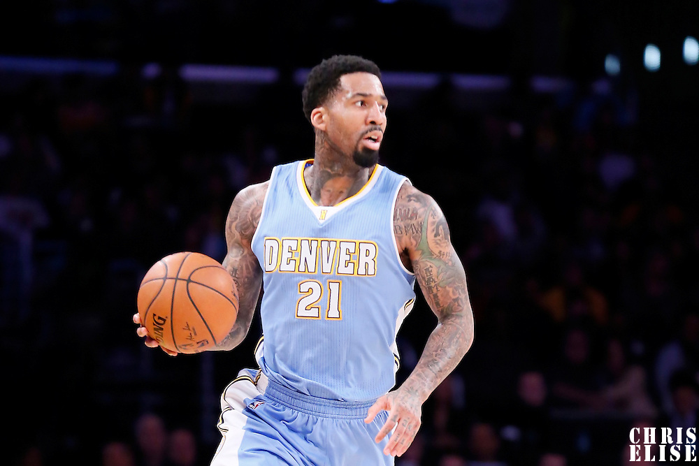 23 November 2014: Denver Nuggets forward Wilson Chandler (21) brings the ball up court during the Denver Nuggets 101-94 overtime victory over the Los Angeles Lakers, at the Staples Center, Los Angeles, California, USA.