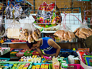 28 MAY 2018 - BANGKOK, THAILAND: A worker in a Burmese snack shop in Phra Khanong Market in Bangkok. The market serves a mix of Thai working class people and immigrants from Myanmar (Burma).     PHOTO BY JACK KURTZ