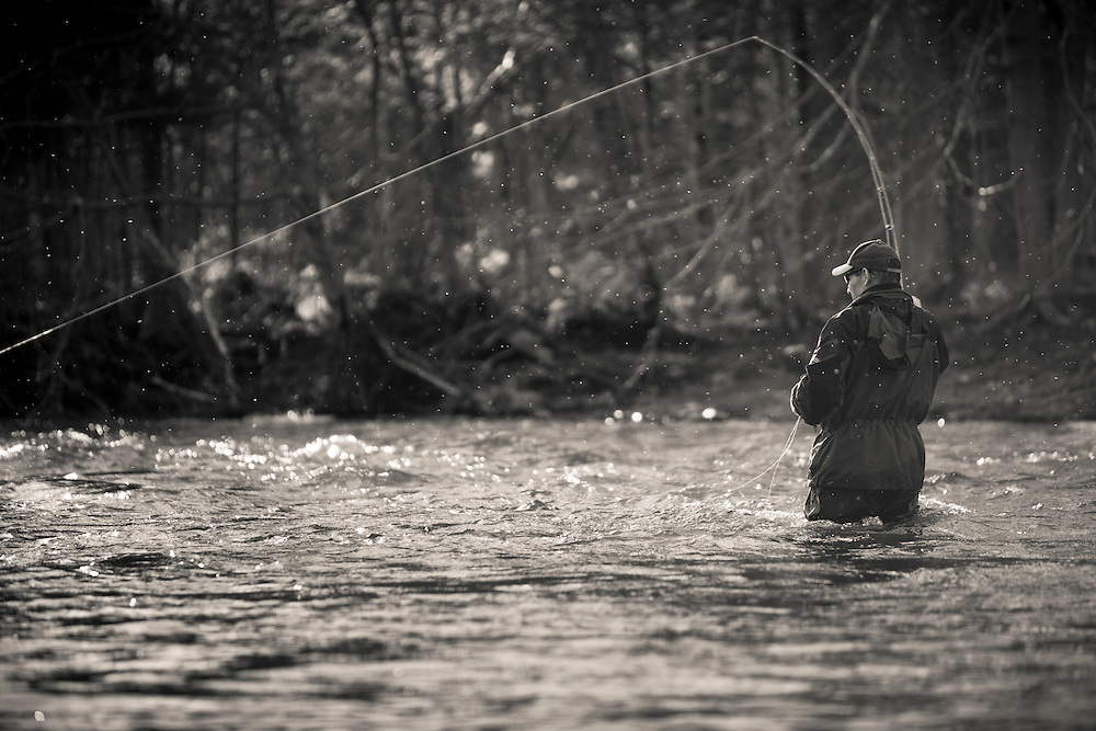 male fly angler fishing for steelhead, Salmon River, New York