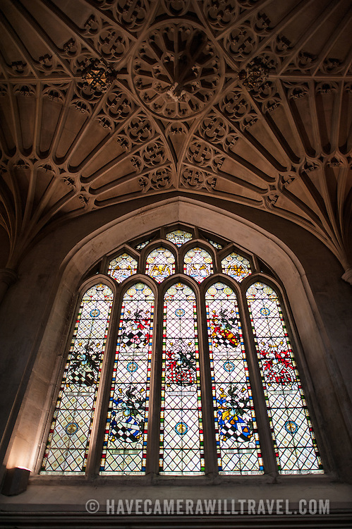 One of several ornate stained glass windows under an equally ornate ceiling at Bath Abbey. Bath Abbey (formally the Abbey Church of Saint Peter and Saint Paul) is an Anglican cathedral in Bath, Somerset, England. It was founded in the 7th century and rebuilt in the 12th and 16th centuries.