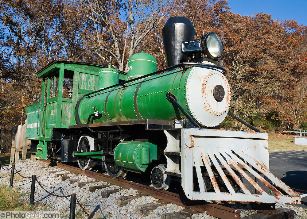 "The restored narrow gauge train steam engine #66, painted green, is exhibited at the unique Natural Tunnel State Park, near Duffield, Virginia (where both a train and a river share the same natural limestone cave). The locomotive was used for the ""Rim Rock Railroad"" which operated as a frontier town and tourist attraction from 1969 to 1974 at the Rim Rock Recreational Park in Norton, Virginia. Current location: N 36° 42.140 W 082° 44.784 (17S E 344001 N 4063273)."
