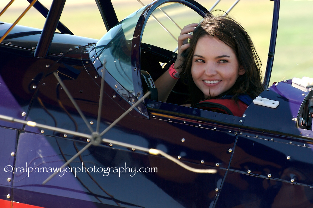 Hillary Swindell prepares for a biplane test ride at the 8th Annual 2007 Moonlight Fund airshow in New Braunfels, Texas. Hillary is the daughter of Moonlight Fund cofounder Celia Jones. The Moonlight Fund provides support services for military and civilian burn victims and their families.