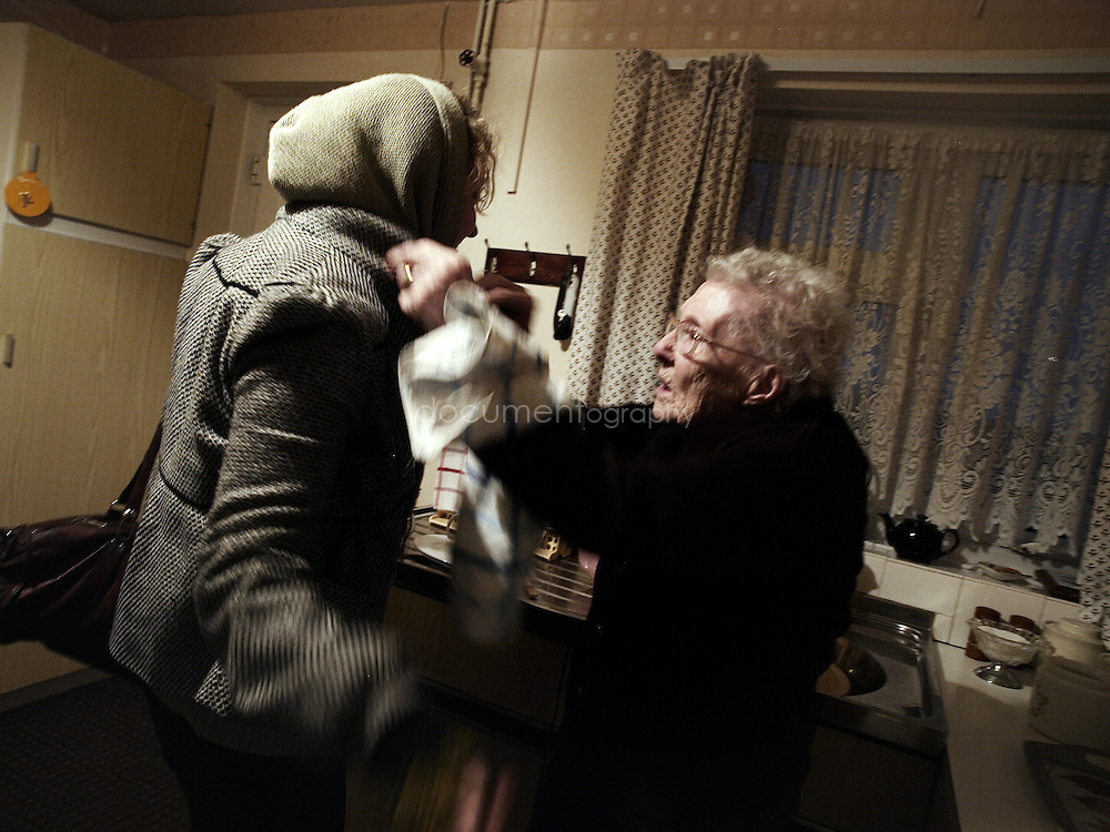 Rachel is about to go and visit her parents; her grand mother is making sure that she is ready for the cold.