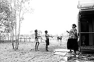 """Yes, cool me down!"", Denise Macale is giving Shanita Andrews and David Macale a cool down , at the remote Biridu community in the Kimberley, temperatures rise easily over the 40 degrees in this part of the world. Western Australia. ©Ingetje Tadros"