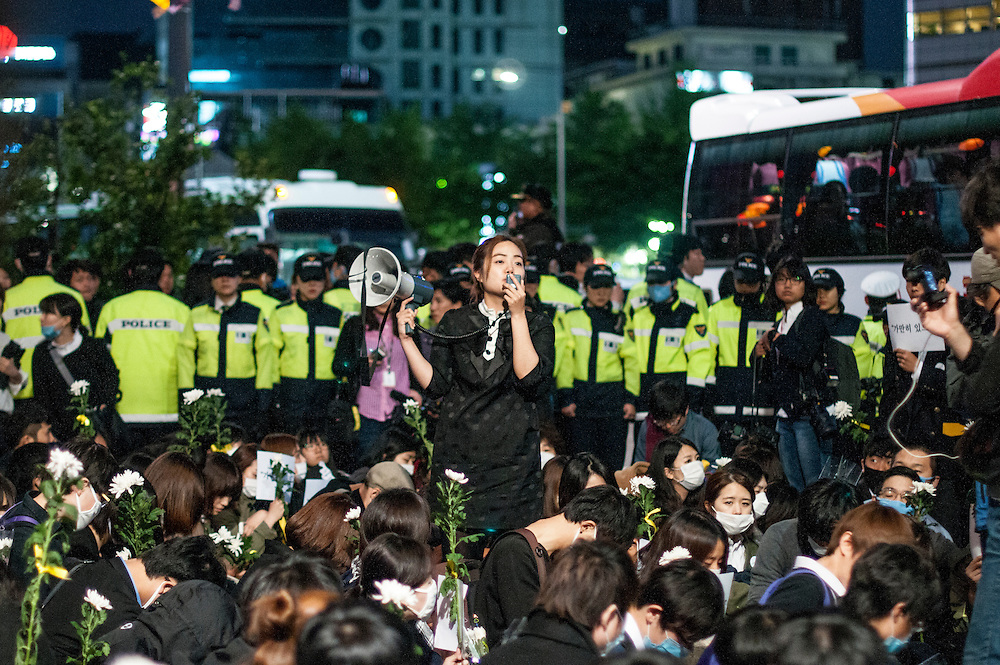 An anti-government protestor speaks during a demonstration in Seoul. About 5,000 people gathered in central Seoul to protest president Park Geun-hye and the government's response to the Sewol ferry sinking tragedy.