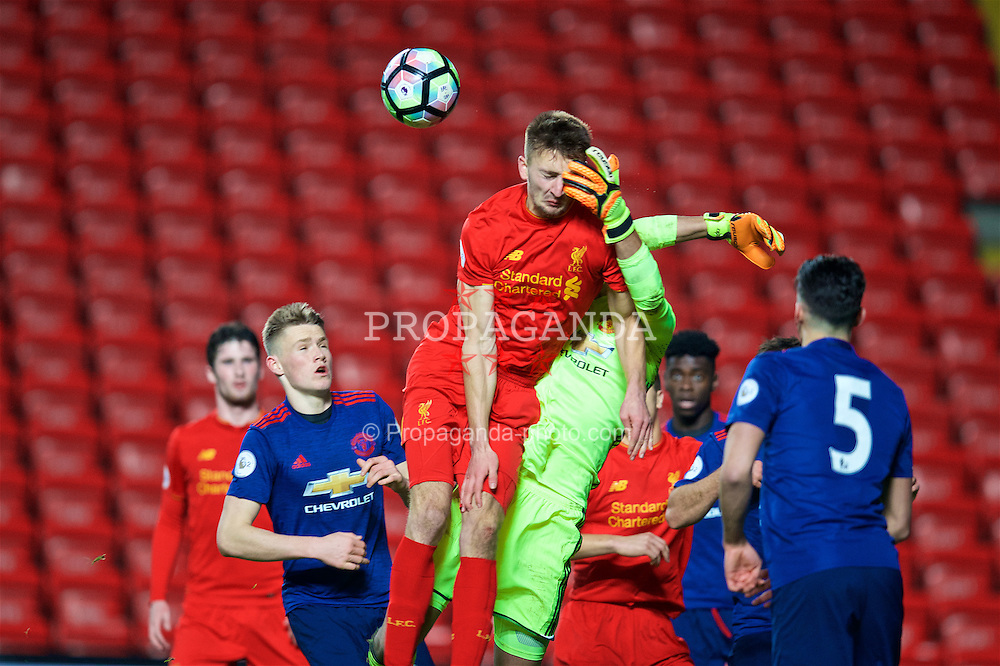LIVERPOOL, ENGLAND - Monday, January 16, 2017: Liverpool's Nathan Phillips in action against Manchester United's goalkeeper Joel Pereira during FA Premier League 2 Division 1 Under-23 match at Anfield. (Pic by David Rawcliffe/Propaganda)