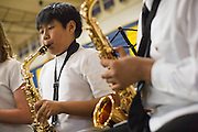 Christian Andrade of Burnett Elementary School, 4th grade, plays the saxophone during the Milpitas Unified School District's Tenth Annual Music Festival at Milpitas High School in Milpitas, California, on April 4, 2013. (Stan Olszewski/SOSKIphoto)