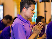 02 APRIL 2015 - CHIANG MAI, CHIANG MAI, THAILAND:  Thais pray in Wat Chedi Luang in Chiang Mai during a prayer service to mark the 60th Birthday celebrations for HRH Princess Maha Chakri Sirindhorn, daughter of Bhumibol Adulyadej, the King of Thailand, and his wife, Queen Sirikit. The Princess is revered by most Thais and her birthday is celebrated throughout Thailand. Thais wear purple on the Princess' birthday because that's the color that marks the day of the week she was born on.   PHOTO BY JACK KURTZ