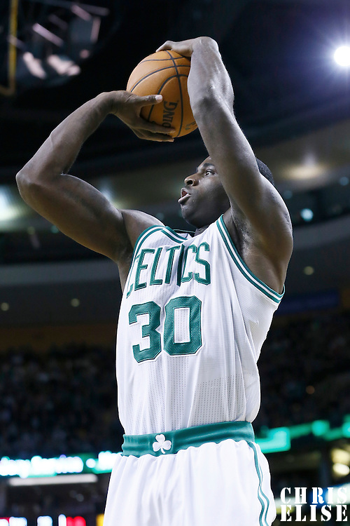 27 January 2013: Boston Celtics power forward Brandon Bass (30) takes a jumpshot during the Boston Celtics 100-98  2OT victory over the Miami Heat at the TD Garden, Boston, Massachusetts, USA.