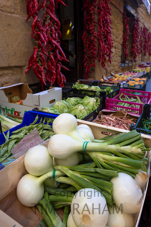 Onions, red chillies and vegetables outside food shop in Laguardia, Rioja-Alavesa, Spain