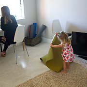 FORT MYERS, FLORIDA, JANUARY 29, 2017<br /> Erin Fahs, 33, uses her computer to have a conference call with two new interns in the company she works for called The Collective Good which does consulting for non profit organizations. Fahs works from her home and got her job using a new company called Werk which connects employees with high level jobs. Her two year old daughter Amelia is with her. Fahs is pregnant with her second child due in March.<br /> (Photo by Angel Valentin/Freelance)