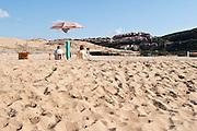 Sardegna, Italy. Costa Verde, Marina di Arbus, Iglesiente, Spiaggia di Pistis. Bagnanti e insediamento presso Torre dei Corsari.