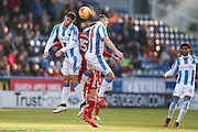 Huddersfield Town defender Christopher Schindler (26), Birmingham City  forward, on loan from Burnley, Lukas Jutkiewicz (15) and Huddersfield Town midfielder Philip Billing (8) battle for the ball in the air during the EFL Sky Bet Championship match between Huddersfield Town and Birmingham City at the John Smiths Stadium, Huddersfield, England on 5 November 2016. Photo by Simon Davies.