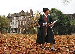 © Licensed to London News Pictures. 07/11/2011. London, UK. Peter aged 10, from The William Hogarth Primary School, wears clothes similar to what Hogarth would have worn in the 18th Century in garden of the house. The restoration project at Hogarth's House, built in 1750, in Chiswick, West London is completed today 7th November 2011. The house, once Hogarth's residence holds a collection of the artist's 18th century prints and engraving plates. The house suffered damage from a major fire during the restoration. Photo credit : Stephen Simpson/LNP