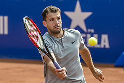April 27, 2018 - Barcelona, Catalonia, Spain - GRIGOR DIMITROV (BUL) returns the ball to Pablo Carreno Busta (ESP) in their quarter final of the 'Barcelona Open Banc Sabadell' 2018.  Carreno Busta won 6:3, 7:6 (Credit Image: © Matthias Oesterle via ZUMA Wire)