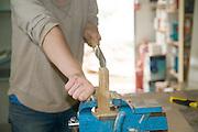 Female carpenter uses a Dozuki Japanese saw the double blade Ryoba