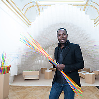 London, UK - 21 January 2014: architect Diébédo Francis Kéré poses next to their installation at the Sensing Spaces: Architecture Reimagined exhibition at the Royal Academy of Arts