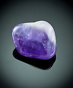 Cutout of an amethyst gemstone on black background