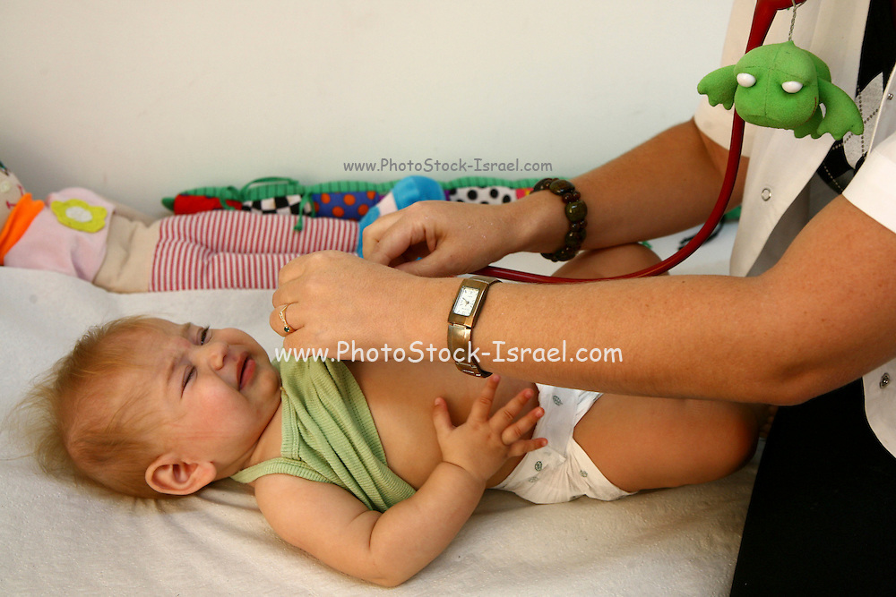 A five month old baby girl during routine visit at the doctor
