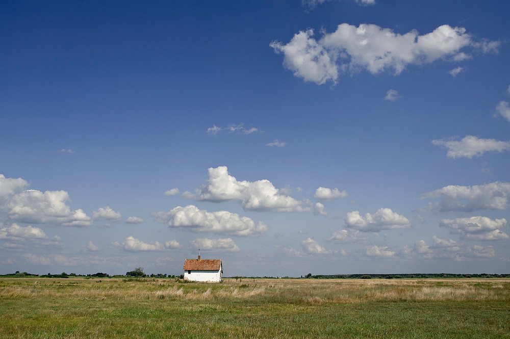 Hortobagy landscape with hut, Hortobagy National Park, Hungary
