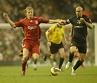 Photo: Aidan Ellis.<br /> Liverpool v Watford. The Barclays Premiership. 23/12/2006.<br /> Liverpool's Dirk Kuyt (L) and Watford's Gavin Mahon