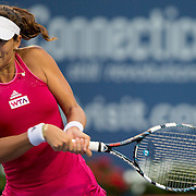 August 21, 2014, New Haven, CT:<br /> Garbine Muguruza hits a backhand during a match against Camila Giorgi on day seven of the 2014 Connecticut Open at the Yale University Tennis Center in New Haven, Connecticut Thursday, August 21, 2014.<br /> (Photo by Billie Weiss/Connecticut Open)