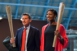 © licensed to London News Pictures. LONDON, UK  08/06/11. Athlete Denise Lewis and chairman of London Organising Committee for the Olympic Games Sebastian Coe, hold up prototype Olympic torches. Ahead of the 2012 London Olympics the prototype Olympic torch is unveiled at St Pancras Station, London. Please see special instructions for usage rates. Photo credit should read Matt Cetti-Roberts/LNP