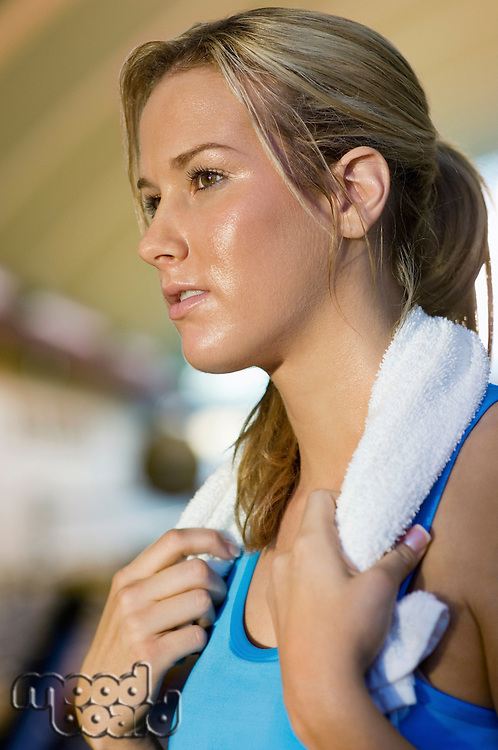 Woman with towel at gym (close-up)