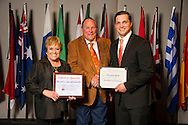 Owasso native Benjamin Sewell (right), an animal science major, receives an Oklahoma State University Win and Kay Ingersoll Scholarship from Win and Kay Ingersoll (left) at the university's recent College of Agricultural Sciences and Natural Resources Scholarships and Awards Banquet. The scholarship is part of more than $1.4 million in scholarships and awards presented to CASNR students for the 2016-2017 academic year. (Photo by Todd Johnson)