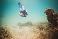 Jacki Arevalo snorkeling in Emerald Bay, the Exumas, Bahamas.