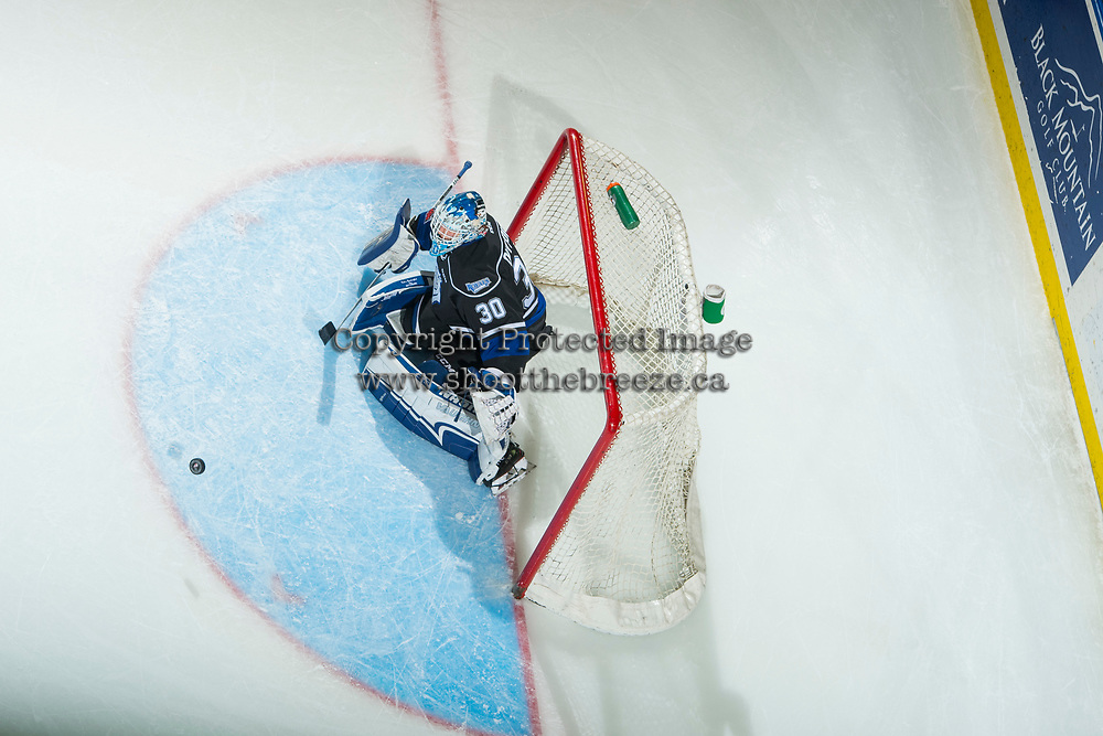 KELOWNA, CANADA - DECEMBER 30: Griffen Outhouse #30 of the Victoria Royals defends the net and makes a save against the Kelowna Rockets on December 30, 2017 at Prospera Place in Kelowna, British Columbia, Canada.  (Photo by Marissa Baecker/Shoot the Breeze)  *** Local Caption ***