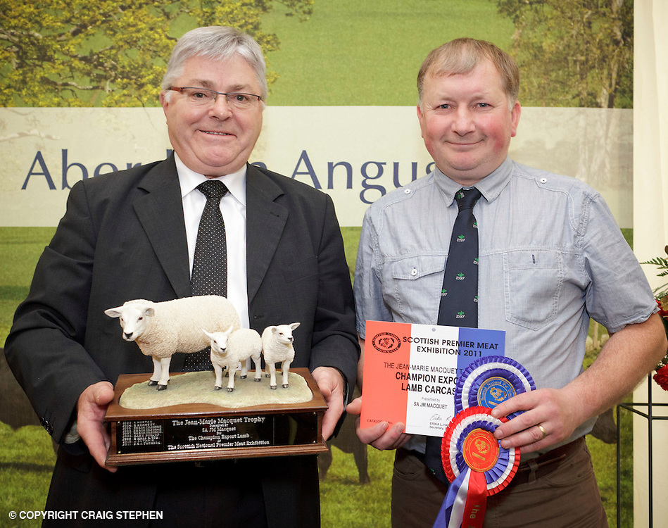 Scottish National Premier Meat Exhibition & competition to promote Scottish livestock from farm to consumer, sponsored by Marks & Spencer. Held at Scotbeef Ltd, Bridge of Allan, Saturday 19th Novermber, 2011...Champion export lamb carcase, D& J Thomson, Pitnacree Farm, Strathtay. Mr Thomson pictured with judge, Andre Huyghe