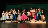 Brenna O'Connor (Kim MacAfee), Camryn Marshall (Ursula) and Nehamiah Manon-Marquis (Conrad Birdie with the Sweet Apple Fan Club during dress rehearsal for Bye Bye Birdie with Gilford Middle School on Tuesday afternoon.  (Karen Bobotas/for the Laconia Daily Sun)