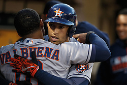 OAKLAND, CA - JULY 19:  George Springer #4 of the Houston Astros is congratulated by Luis Valbuena #18 after hitting a home run against the Oakland Athletics during the fifth inning at the Oakland Coliseum on July 19, 2016 in Oakland, California. (Photo by Jason O. Watson/Getty Images) *** Local Caption *** George Springer; Luis Valbuena