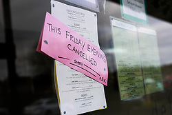 A sign in a restaurant window reads 'this Friday evening cancelled' during the Corona Virus Pandemic of 2020<br /> <br /> Ben Booth | 20/03/2020