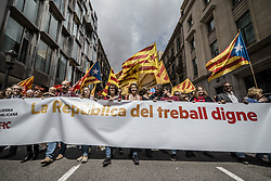 May 1, 2017 - Barcelona, Catalonia, Spain - Pro-independence demonstrators with their waving banners from the ERC party march behind their banner during a manifestation organized by the mayor unions CC.OO and UGT, to protest the Troika, the austerity measures and the government under the slogan on 1st of May. (Credit Image: © Matthias Oesterle via ZUMA Wire)