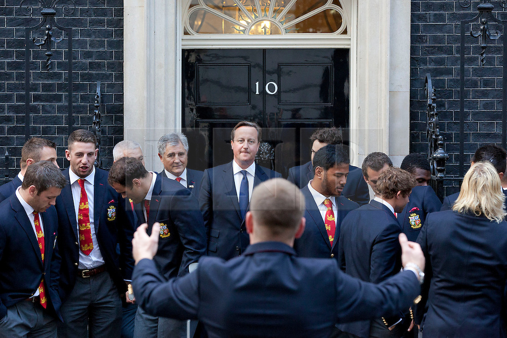 © Licensed to London News Pictures. 16/09/2013. London, UK. The British Prime Minister, David Cameron, is seen amongst members of the British Lions Rugby Team as they get ready for a team picture on the steps of Number 10 Downing Street before they attend a reception celebrating their victory in Australia this summer. Photo credit: Matt Cetti-Roberts/LNP