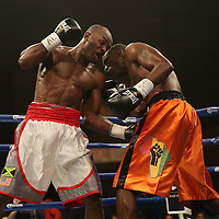 "Cecil McCalla (white shorts) beats Antonio Fernandes during the undercard of the ESPN ""Boxcino"" boxing tournament at Turning Stone Resort Casino on Friday, April 18, 2014 in Verona, New York.  (AP Photo/Alex Menendez)"