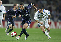 "PORTUGAL - PORTO 23 FEBRUARY 2005: LUIS FABIANO #9 drives the ball pursued  by GIUSEPPE FAVALLI #16, in the First Knock-out Round First Leg of the UEFA Champions League, match FC Porto (1) vs FC Internazionale (1), held in ""Dragao"" stadium  23/02/2005  20:50:01<br />