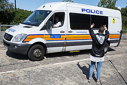 London, UK. 4 September, 2019. An activist shows solidarity with one of several anti-nuclear campaigners arrested after locking themselves together to block one of the two main access routes to ExCel London during protests on the third day of a week-long carnival of resistance against DSEI, the world's largest arms fair. The third day's protests were organised by the Campaign for Nuclear Disarmament (CND) and Trident Ploughshares.
