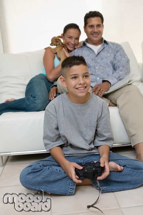 Parents Watching Son Play Video Games