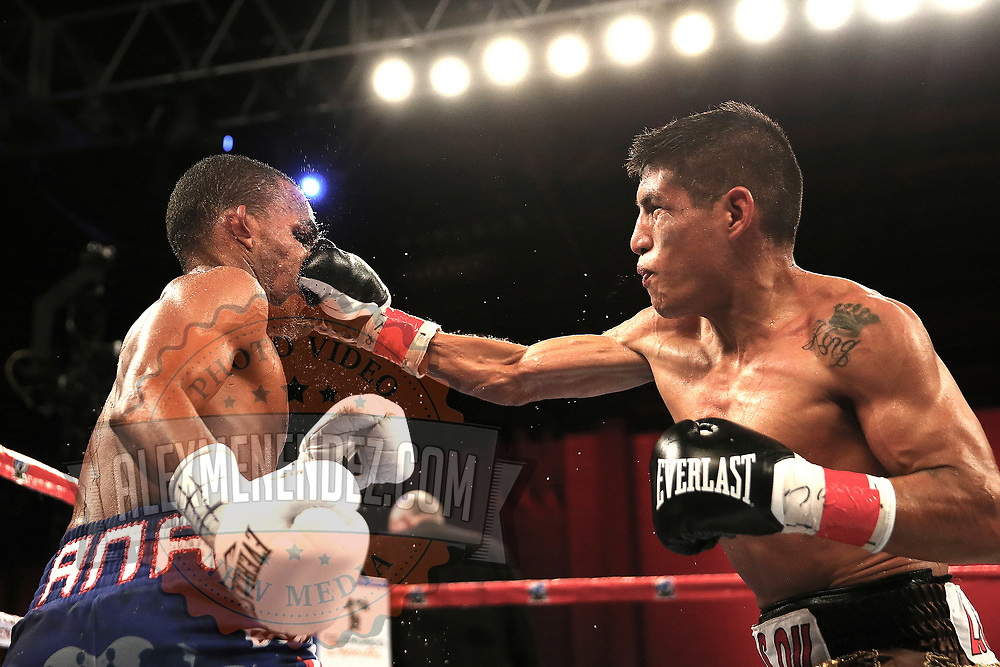 Richard Rodriguez (R) lands a shot the head of Jonathan Gonzalez during a Telemundo boxing match between at Osceola Heritage Park on Friday, February 23, 2018 in Kissimmee, Florida.  (Alex Menendez via AP)