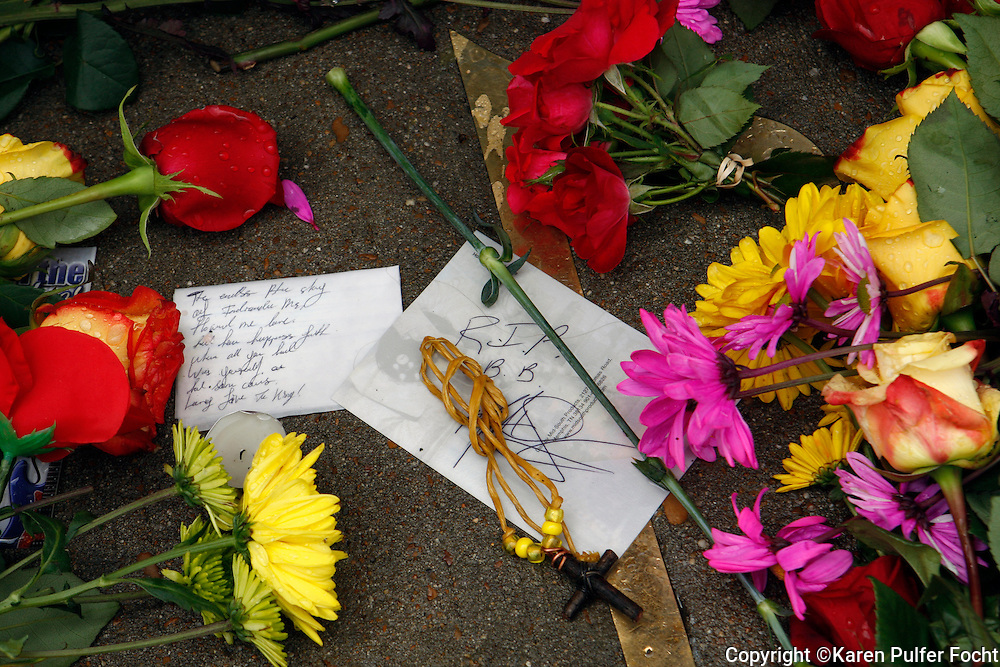 Fans paid their respects to B.B. King outside of this Memphis Blues Club by laying flowers on the musical note dedicated to him on Beale Street in Memphis. B.B. was a nick name given to him on Beale Street. B.B. His nick name was Beale Street Blues Boy.