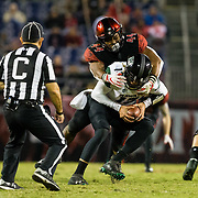 24 November 2018: San Diego State Aztecs linebacker Kyahva Tezino (44) sacks Hawaii Warriors quarterback Cole McDonald (13) in the fourth quarter with the Aztecs trailing 24-17. The Aztecs closed out the season with a 31-30 overtime loss to Hawaii at SDCCU Stadium.